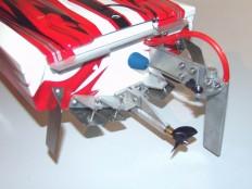 Traxxas Spartan Trimmklappenverstellung und Spritzschutz